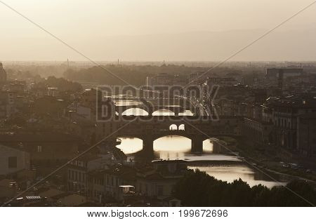 Evening view of the bridges in Florence, Italy
