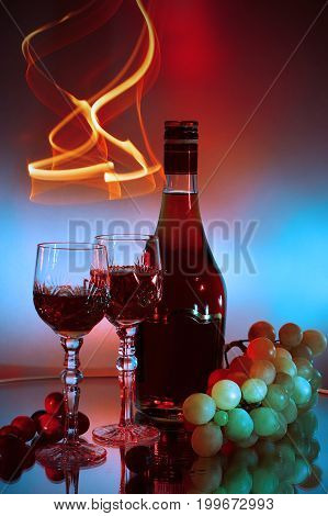 Bottle glass of cognac (brandy) and bunch of grapes