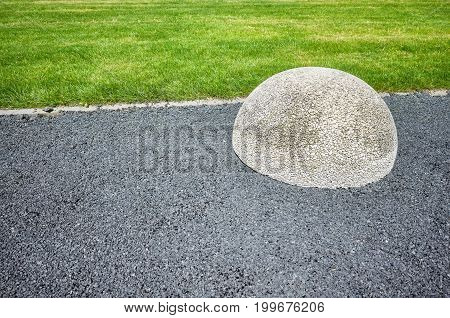 Asphalt Floor, Lawn And Hemisphere Barrier.