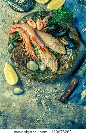 Image of fresh seafood, shrimp on plate with greens