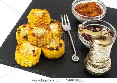 Spicy corn grill on black stone. Studio Photo