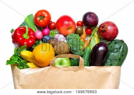 Full paper bag of different fruits and vegetables on a white background. healthy food. Top view. Flat lay