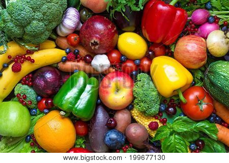 Assortment of fresh fruits vegetables and berries. healthy eating. top view