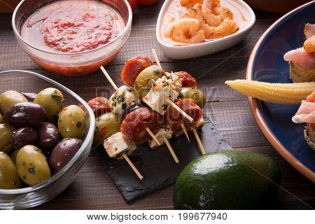 Mediterranean starters tapas on wooden vintage table