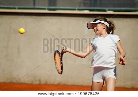 Young Girl Practicing Forehand. Color Image, Outdoors