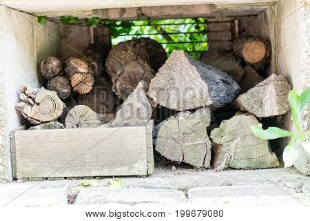 stacked firewood front shot in chimney on concrete