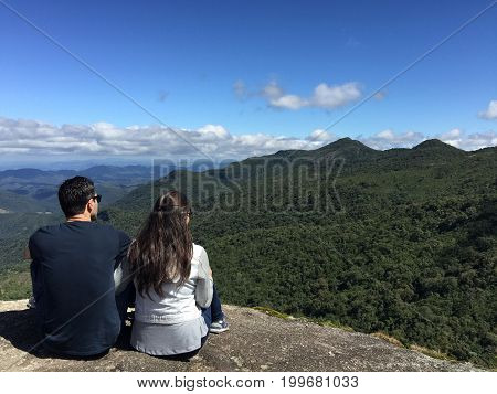 Couple At The Top Of  A Mountain In  Monte Verde, Minas Gerais, Brazil.