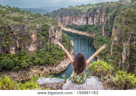 Freedom Traveler Woman With Raised Arms On The Top Of Furnas Canyon Enjoying The Beautiful Landscape