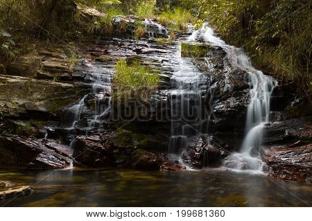 Waterfall Closeup Long Exposure. Beautiful Waterfall In The Forest. Natural Water Spring Waterfall.