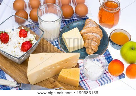 Set of dairy products, honey, fruit for healthy diet. Studio Photo