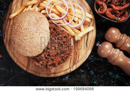 Sloppy joes ground beef burger sandwich with onion and french fries