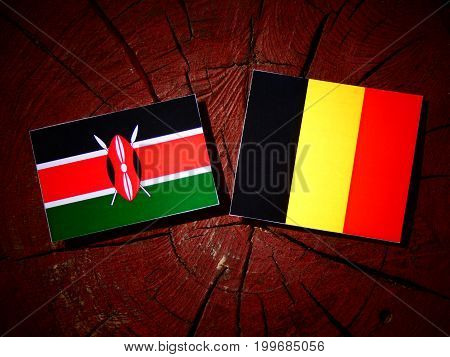 Kenyan Flag With Belgian Flag On A Tree Stump Isolated