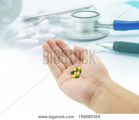 Medical, Hand Holding Capsule Pills, Stethoscope, Pills And Document Abstract Background