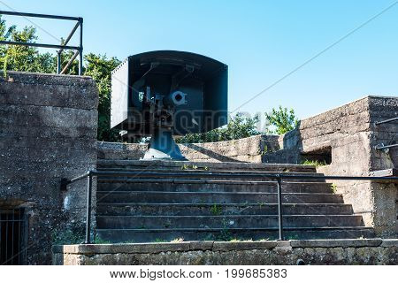 Rear view of an Endicott-era, 3-inch, rapid-fire gun on the upper level of Battery Irwin at Fort Monroe, a decommissioned military installation built between 1819 and 1834 in Hampton, Virginia.