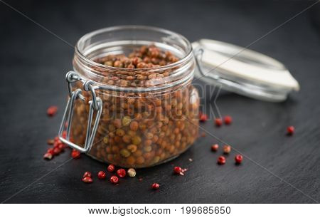 Preserved Pink Peppercorns On A Slate Slab, Selective Focus