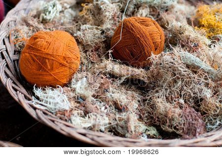 Orange wool clews