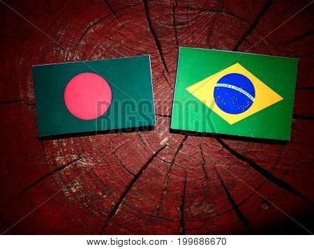 Bangladesh Flag With Brazilian Flag On A Tree Stump Isolated