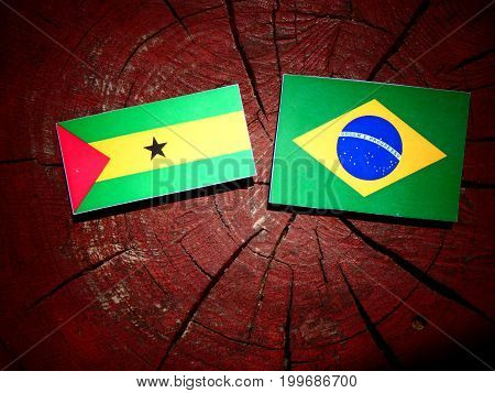 Sao Tome And Principe Flag With Brazilian Flag On A Tree Stump Isolated