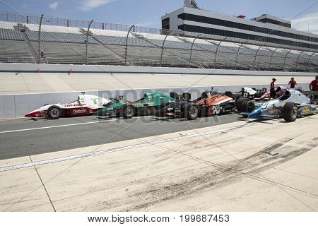 Irl Open Wheel Racing Cars On Pit Row