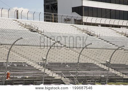 Empty Seats In Stands Of Motor Speedway