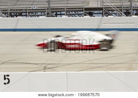 Blur Of Irl Car On Track Of Motor Speedway.