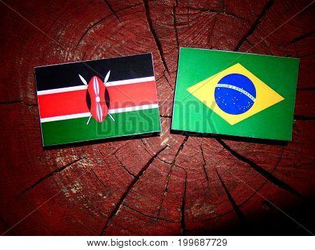 Kenyan Flag With Brazilian Flag On A Tree Stump Isolated