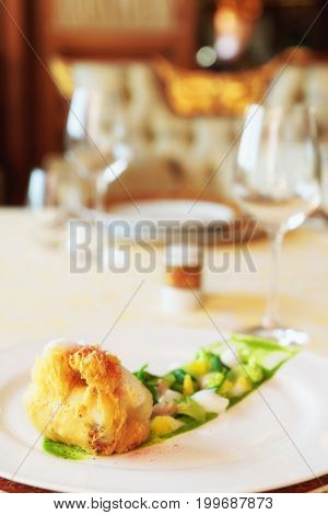 Fish tempura with greens, gourmet dish in an expensive restaurant, toned image