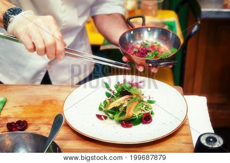 Professional chef is making vegetable appetizer, toned image