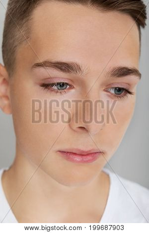 The portrait of sad teenage boy. Adolescence problem.