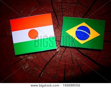 Niger Flag With Brazilian Flag On A Tree Stump Isolated