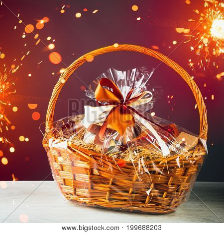 gift basket with festive sparklers particles