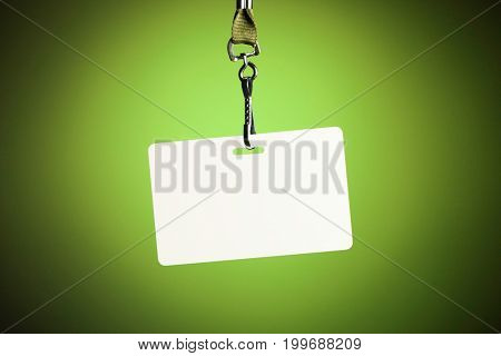 empty white badge backdrop against green background