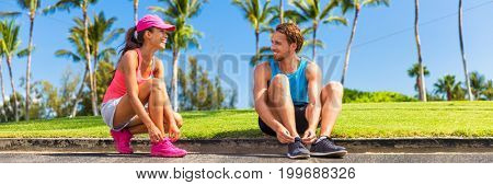 Runners couple tying running shoes to run banner. Runner woman and athlete man lacing shoe laces at park. Healthy lifestyle jogging motivation, happy healthy people. Horizontal landscape crop.