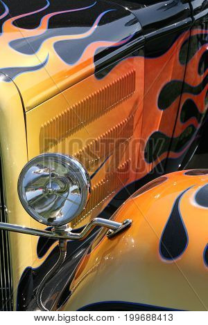 classic hot rod with orange and black flames