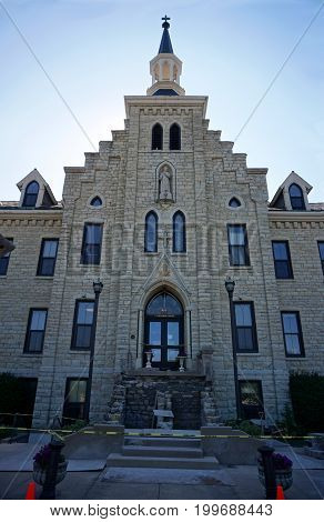 JOLIET, ILLINOIS / UNITED STATES - JULY 19, 2017: A view of the front entrance of the historic Welcome Center at the University of Saint Francis.