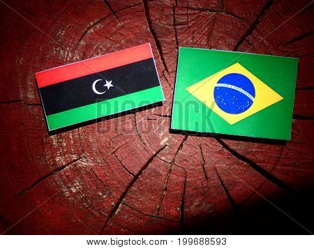 Libyan Flag With Brazilian Flag On A Tree Stump Isolated