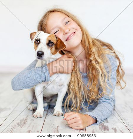Happy child with dog. Portrait girl with pet