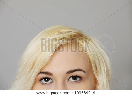 The portrait of woman looking up isolated on white background.