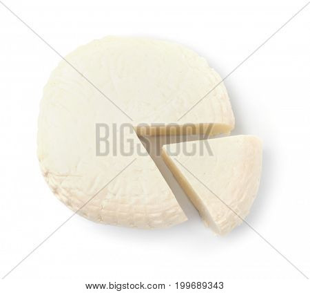 Top view of brined cheese wheel isolated on white