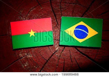 Burkina Faso Flag With Brazilian Flag On A Tree Stump Isolated