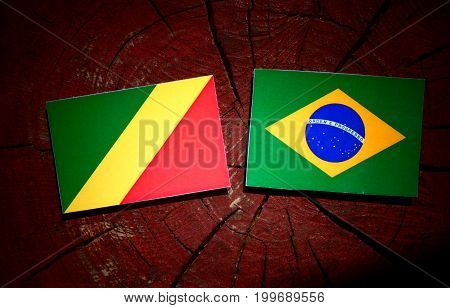Republic Of The Congo Flag With Brazilian Flag On A Tree Stump Isolated