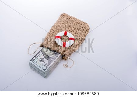 Life Preserver On The Banknote Bundle Of Us Dollar