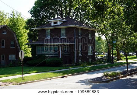 JOLIET, ILLINOIS / UNITED STATES - JULY 18, 2017: A two story, brown brick, single family home, in Joliet's Historic Cathedral Area.