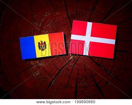 Moldovan Flag With Danish Flag On A Tree Stump Isolated