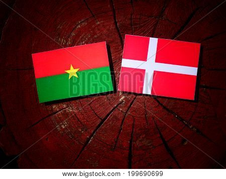 Burkina Faso Flag With Danish Flag On A Tree Stump Isolated