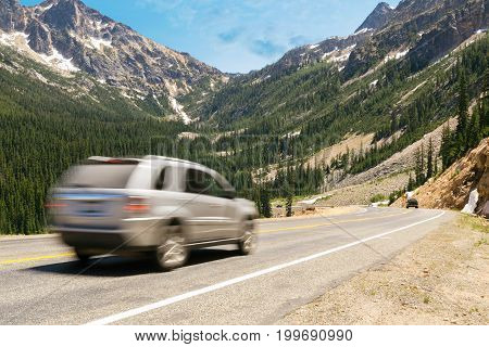 Vehicles driving on the scenic Cascade Loop highway in Washington.