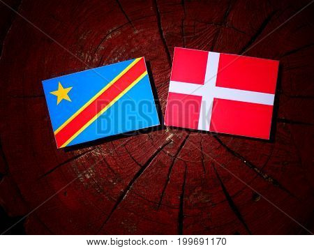 Democratic Republic Of The Congo Flag With Danish Flag On A Tree Stump Isolated