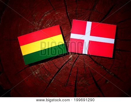 Bolivian Flag With Danish Flag On A Tree Stump Isolated
