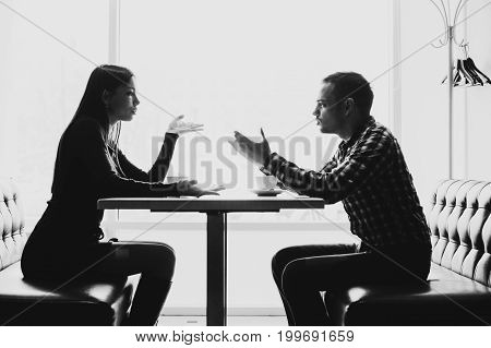 Man and woman in discussions in the restaurant.