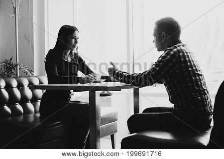 Scene in cafe - couple conflict arguing during the lunch